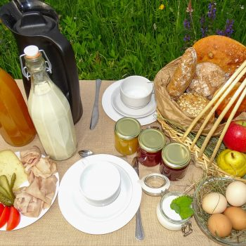 Breakfast table at the Schmalzlhof with new holiday apartments in Siusi allo Sciliar