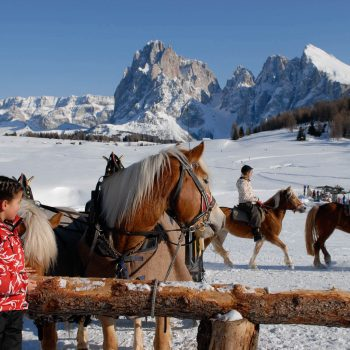 Riding over the winter landscape of the Seiser Alm