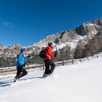 Snowshoeing in the untouched winter landscape of the Dolomites